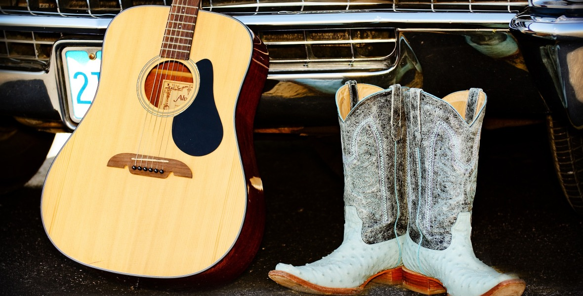 guitar, cobwboy boots, truck, Toby Keith storytelling content marketing lessons